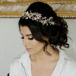 bridal hairstyle loose chignon with pearl hair jewellery