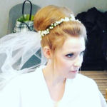 bridal hairstyle updo with floral tiara and veil