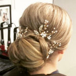 bridal hairstyle chignon with floral hair jewellery