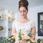 bridal hairstyle updo with floral bouquet