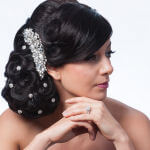 bridal hairstyle chignon with curls and crystal pins