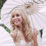bridal hairstyle blond with long loose curls and bangs